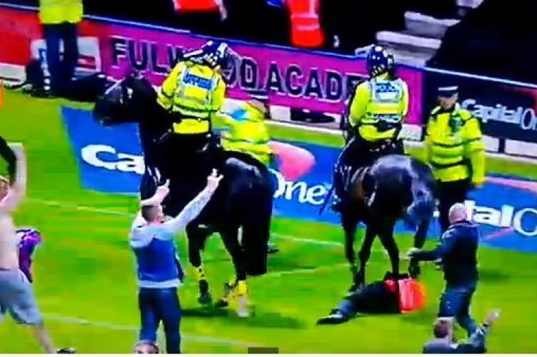 A police horse tramples on a steward.
