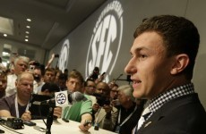 Johnny Football banned for half a game, book closed on autograph controversy