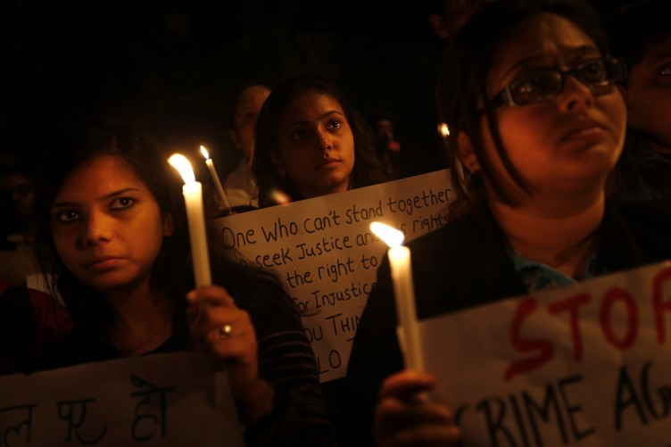 Indian students participate in a candlelight vigil to mark the passing the 23-year-old student who was gang-rape on a bus in New Delhi, India.