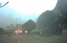 Giant boulder almost crushes car in dashcam video