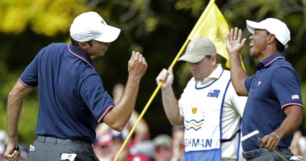Tiger and Kuuuuuch are celebrating their birdies with a 'Fresh Prince' handshake
