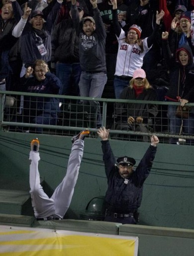 A perfectly-timed photo of a Boston cop celebrating David Ortiz's home run