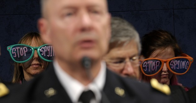 Photobomb protestors tell the NSA to 'stop spying'