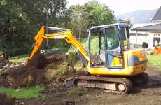 Two-year-old boy drives full-size digger