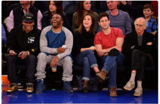 Larry David could not look any unhappier at having to attend NBA game