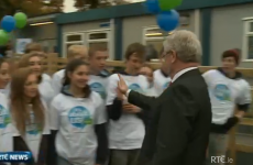 Watch Eamon Gilmore go in for a super awkward high-five (GIF)