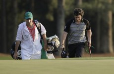 In the swing: McIlroy's caddy has many questions to answer