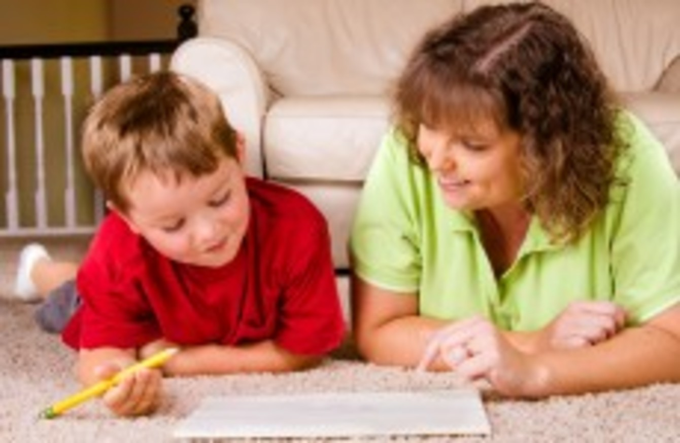 Parents Helping Their Children With Homework   Stock Image Parents
