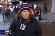 Fan tries to videobomb reporter, falls amusingly on his arse