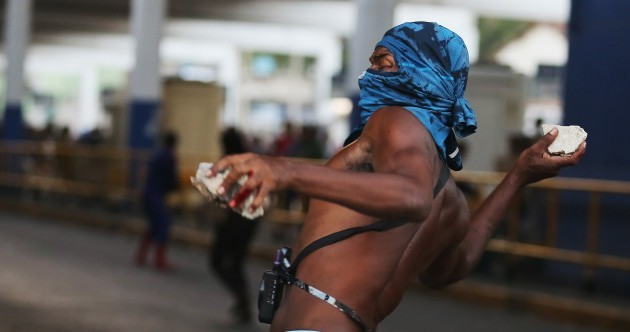 Pictures: Tear gas fired & running battles with police, in protest at transport hikes in Rio