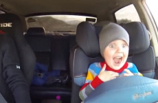 Kid experiences pure joy while taking a ride in a drift car