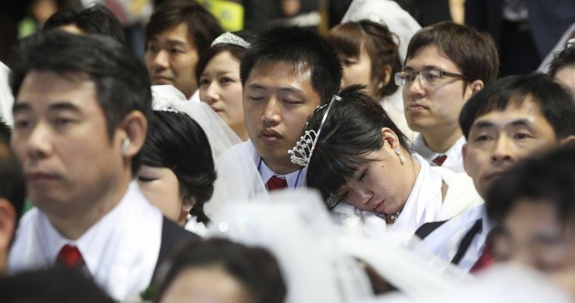 PICS: 2,500 couples marry, take selfies and nap at South Korean mass wedding