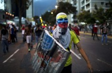 Students hit with water cannons and tear gas in Venezuela protests