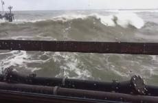 Huge wave smashes through restaurant window as people eat breakfast