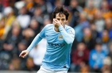 Ten-man Manchester City trim Chelsea's lead
