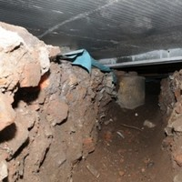 Thieves dig 50ft tunnel into Tesco to steal cash from an ATM...and get away with it