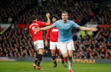 Dzeko downs tepid United to give City derby spoils