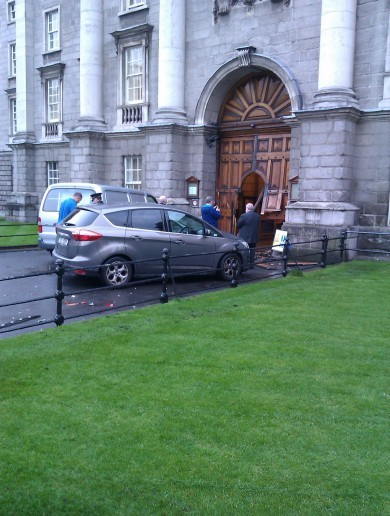 Car driven by 68-year-old crashes into the front gate of Trinity College