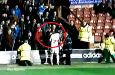 Crawley player gives a fan in the stands a clip around the ear