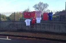 Fans are now hanging football jerseys on the Liam Whelan bridge
