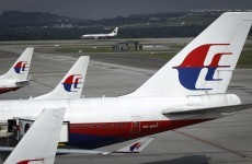 Malaysia Airlines flight makes safe emergency landing after a landing gear failure