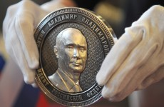Putin's face appears on coin marking Crimea's annexation