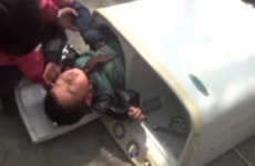 Little boy rescued after getting stuck in washing machine