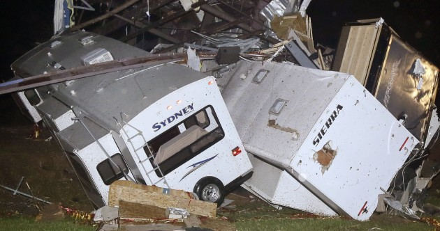 """It's chaos"": At least 10 killed as powerful tornadoes tear across southern US"