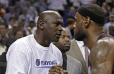 Snapshot: Michael Jordan and LeBron James hug it out as Miami burn off Bobcats