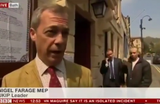 Man makes w*nker sign behind UKIP leader Nigel Farage on live telly