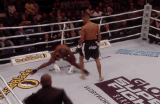 KO'ed kickboxer does the splits after roundhouse blow to the chest