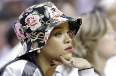 Having fun? Rihanna watches Miami Heat masterclass in how to kill a tight game