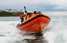 Fisherman rescued after boat runs aground