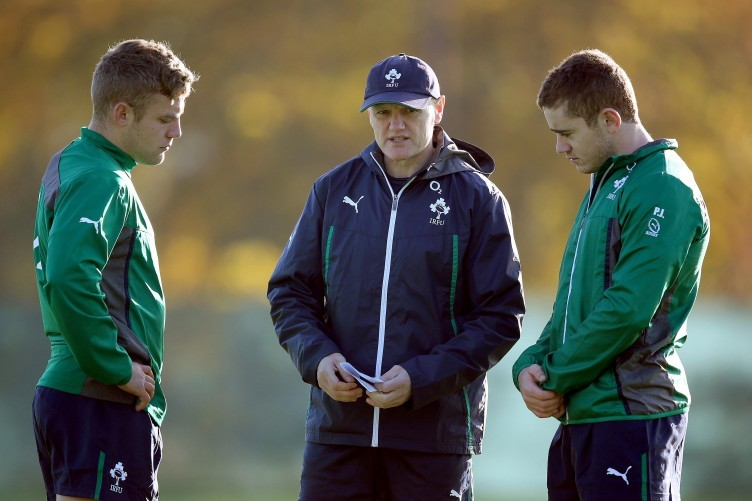 Out-halves Ian Madigan (left) and Paddy Jackson speak with Ireland coach Joe Schmidt.