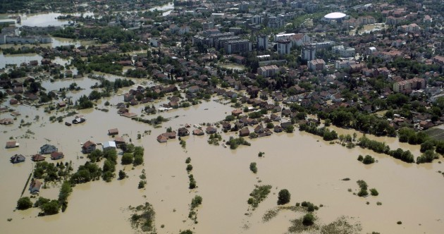 """This is Armageddon"": Thousands flee Balkans floods in Bosnia's worst exodus since war"