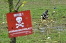 Floods unearth land mines in Bosnia - and wash away warning signs