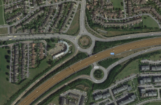 Woman dies after falling from bridge on M50