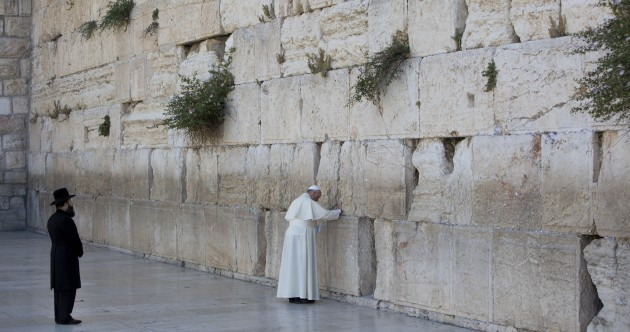 Pope Francis made an unexpected stop at the Western Wall to pray and leave a note