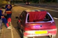 Men wearing superman outfits pulled over for driving car with red cape