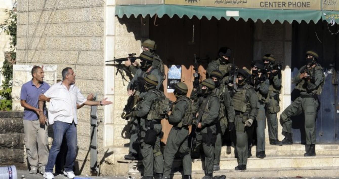 Image result for palestinians queue at israeli border crossing