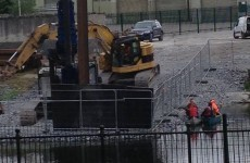 Work on Kilkenny bridge resumes - while protesters are nearby on river