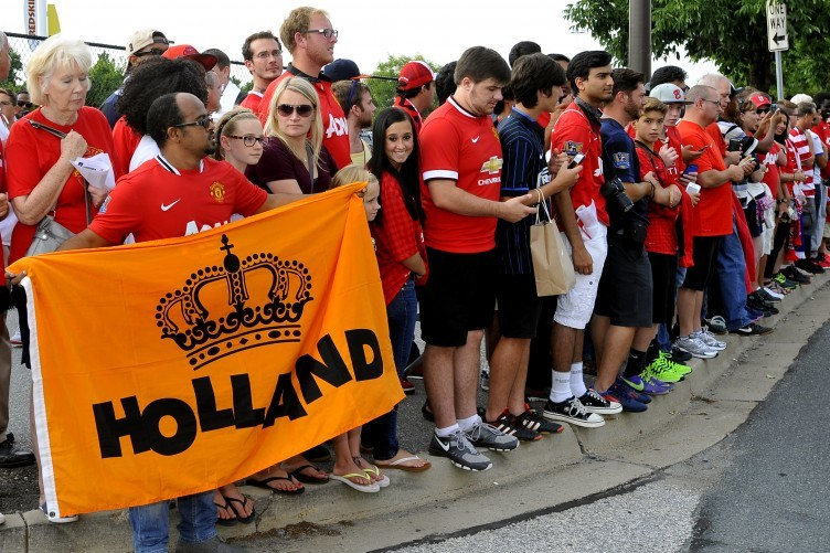 United fans in Maryland wait for the players and their new boss earlier this week.