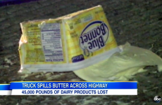 Truck crash coats US highway in butter