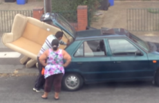 Watch three people trying to stuff one large sofa into a small car