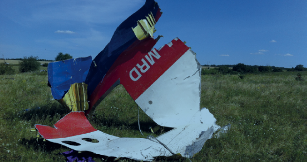 Flight MH17 broke up in the air after being pierced by 'high-energy objects'