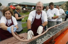 50 people actually volunteered to help grill a 100-foot long sausage