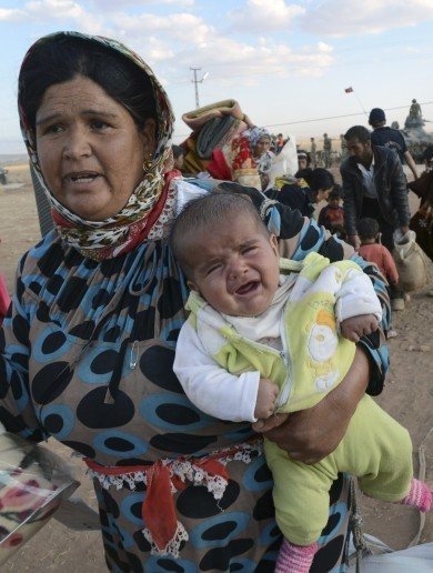 Fleeing ISIS: More than 130,000 Syrian Kurds have now crossed into Turkey
