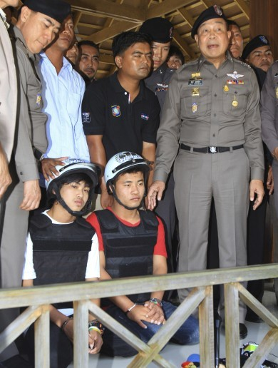 Thailand: Two charged with murdering British tourists after 'bizarre and inept' investigation