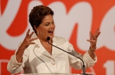 Brazil's president sees off ex-maid and 'smooth operator' to win first-round vote
