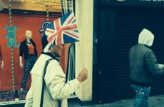 There's a guy leading a group of tourists up Grafton Street with a Union Jack